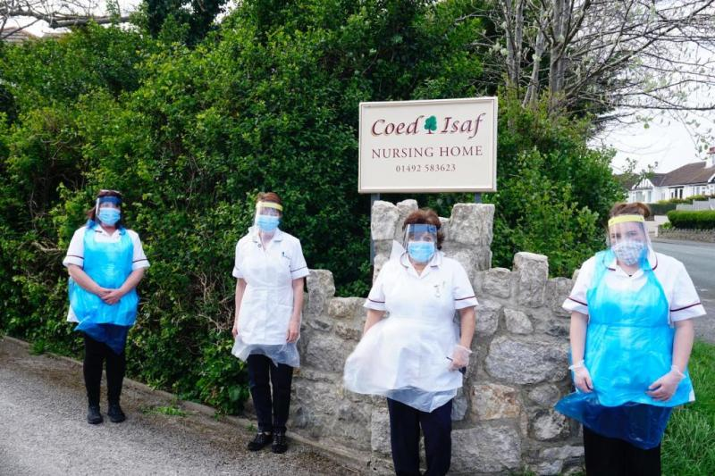 Staff at a care home in North Wales, wearing PPE made at St Benedict's School, Ealing
